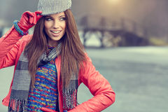 Beautiful brunette girl in autumn park. Warm sunny da Stock Photography