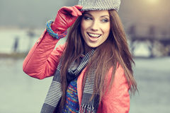 Beautiful brunette girl in autumn park. Warm sunny da Stock Image