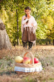 Beautiful brunette girl with basket of ripe apples Stock Photos