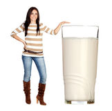 Beautiful brunette girl with a big glass of milk Royalty Free Stock Photography