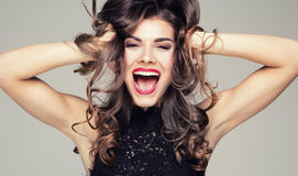 Beautiful brunette girl with big smile. Beautiful brunette woman with amazing toothy smile. Emotions. Happiness. Studio shot Royalty Free Stock Photo