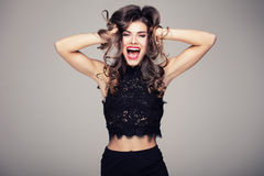Beautiful brunette girl with big smile. Beautiful brunette woman with amazing toothy smile. Emotions. Happiness. Studio shot Stock Images