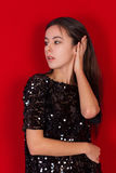 Beautiful brunette girl in a black dress. Brunette with long black hair Royalty Free Stock Images