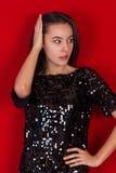 Beautiful brunette girl in a black dress. Brunette with long black hair Stock Photo