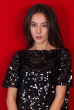 Beautiful brunette girl in a black dress. Brunette with long black hair Royalty Free Stock Image