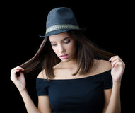 Beautiful brunette girl in black hat and black sweater Stock Photography