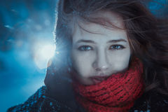 Beautiful brunette girl blowing star dust - winter portrait Royalty Free Stock Image