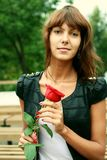 Beautiful brunette girl with Bud of the rose Royalty Free Stock Photography