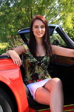 Beautiful brunette girl classic car Stock Images