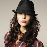 Beautiful brunette girl with classic hat Royalty Free Stock Photography