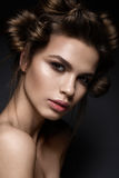 Beautiful brunette girl with a creative hairstyle and dark makeup. Art beauty, fashion model. Beauty face. Photo was made in studio Royalty Free Stock Photo
