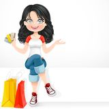 Beautiful brunette girl with a credit cards in his hand Royalty Free Stock Photos