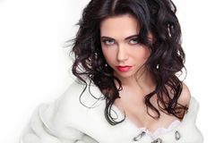 Beautiful Brunette Girl with curly hair in fur coat isolated whi Royalty Free Stock Photography