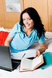 Beautiful brunette girl doing homework Royalty Free Stock Photos