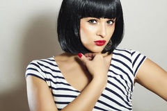 Beautiful Brunette Girl in Dress. Black Hair. bob Haircut. Red Lips. Beauty Woman with Fringe Stock Images