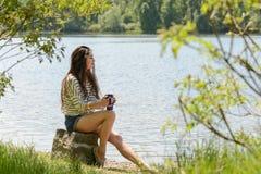 Beautiful brunette girl drinking takeaway Royalty Free Stock Photography