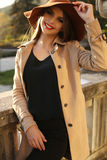 Beautiful brunette girl in elegant clothes posing in autumn park Royalty Free Stock Images
