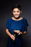 Beautiful brunette girl in evening dress smiling, holding champaign glass. Stock Photo