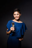 Beautiful brunette girl in evening dress smiling, holding champaign glass. Royalty Free Stock Images