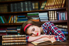 Beautiful brunette girl exhausted and unhappy from all the studying. Stock Photography