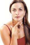 Beautiful Brunette Girl. Fashion Model Girl Portrait. Brown Jewe Royalty Free Stock Photography