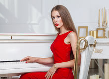 Beautiful brunette girl in a fashionable evening dress. Red lips. Studio shot Royalty Free Stock Photography