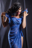 Beautiful brunette girl with flowing hair in blue lace dress Royalty Free Stock Images