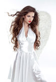 Beautiful brunette girl with fluttering hair. Angel model woman Stock Photo