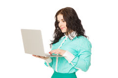 Beautiful brunette girl in green skirt and blouse holding laptop Royalty Free Stock Photo