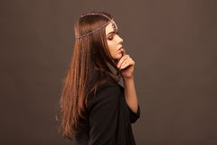 Beautiful brunette girl with hair curled tail stock image