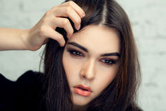 Beautiful brunette girl with hair curled tail stock photos