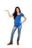 Beautiful brunette girl with a hand extended holding something. On white background Stock Image