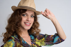 Beautiful brunette girl in hat Stock Photography