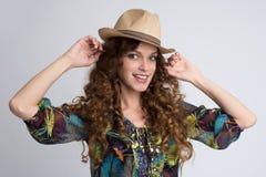Beautiful brunette girl in hat Stock Photo