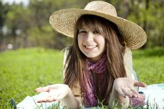 Beautiful brunette girl in hat at the park Stock Image