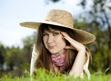 Beautiful brunette girl in hat at the park Royalty Free Stock Image
