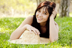 Beautiful brunette girl in hat at the park. Stock Images