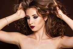 Beautiful brunette girl with healthy curly hair Royalty Free Stock Photo