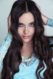 Beautiful Brunette Girl. Healthy Long Curly Hair. Stock Photos