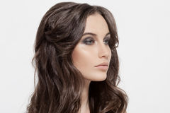 Beautiful Brunette Girl. Healthy Long Curly Hair. Royalty Free Stock Photo