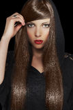 Beautiful Brunette Girl. Healthy Long Hair. Beautiful girl with healthy long hair isolated on black background Stock Photo