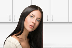 Beautiful Brunette Girl with Healthy Long Hair. In kitchen Stock Photography