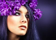 Beautiful Brunette Girl. Healthy Long Hair. purple flowers. Stock Photography