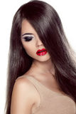 Beautiful Brunette Girl with Healthy Long Hair and Red Lips.  Fa. Shion Model Woman with Long Healthy Brown Hair Isolated on white background Royalty Free Stock Images