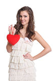 Beautiful brunette girl with a heart sign Stock Images