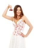 Beautiful brunette girl holding cherries Stock Photos