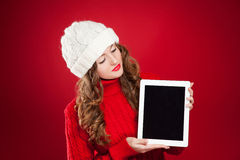 Beautiful brunette girl holding ipad royalty free stock photos