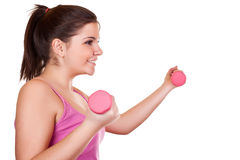 Beautiful brunette girl holding a pink weight Royalty Free Stock Photos