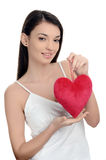 Beautiful brunette girl holding a red heart. Happy woman, Valentine day. Stock Photos
