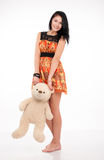 Beautiful brunette girl holding a teddy bear Royalty Free Stock Photography